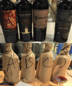 """Three whiskey barrel aged reds with a """"regular"""" red blend ringer. (Not wrapped up in the same order. See reveal below)"""