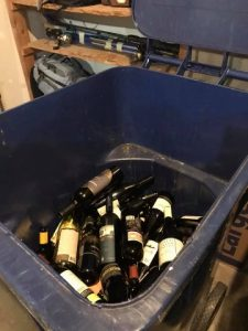 recycle bin filled with bottles